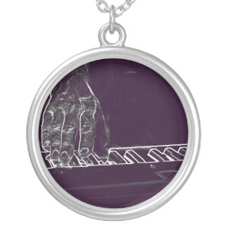 hand playing keyboard purple white ink outline round pendant necklace