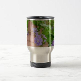 Hand, purple flowers, leaves mugs