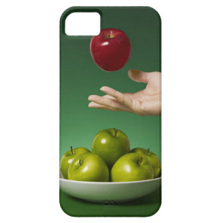 hand tossing red apple in the air and green iPhone 5 case