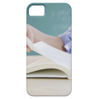 Hand turning page in book iPhone 5 cover