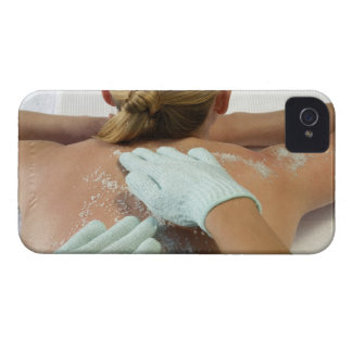 Hands applying exfoliating scrub iPhone 4 Case-Mate cases