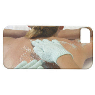 Hands applying exfoliating scrub iPhone 5 cases