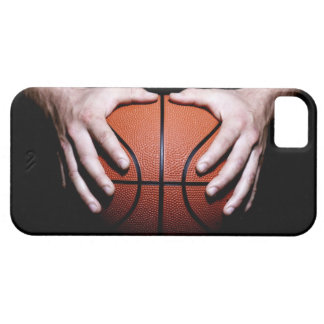 Hands holding a basketball case for the iPhone 5