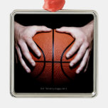 Hands holding a basketball christmas ornaments