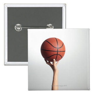 Hands holding a basketball,hands close-up 15 cm square badge
