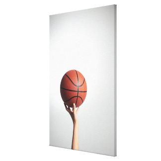 Hands holding a basketball,hands close-up canvas print