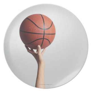 Hands holding a basketball,hands close-up plate
