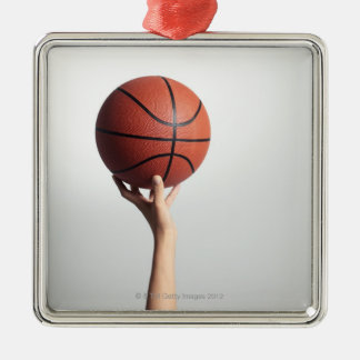 Hands holding a basketball,hands close-up Silver-Colored square decoration