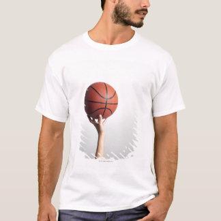 Hands holding a basketball,hands close-up T-Shirt