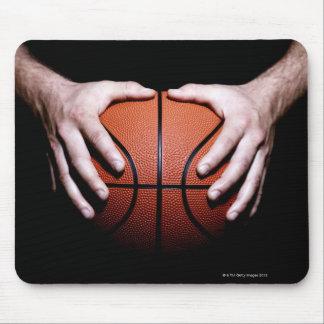 Hands holding a basketball mouse mat
