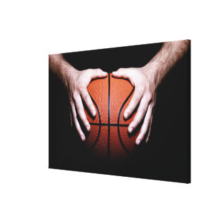 Hands holding a basketball stretched canvas print