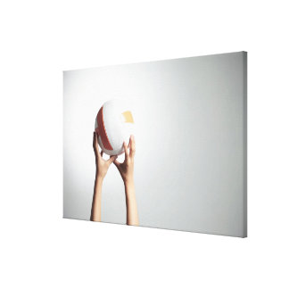 Hands holding a volleyball,hands close-up canvas print