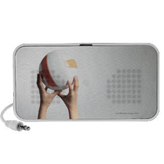 Hands holding a volleyball,hands close-up iPod speaker