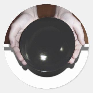 Hands Holding an Empty Bowl Round Sticker