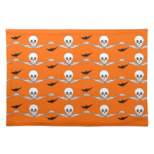 Hands holding skulls place mat