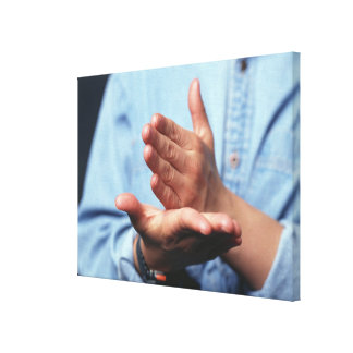 Hands making gesture: one hand held straight on stretched canvas print
