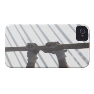Hands of a male gymnast gripping a horizontal iPhone 4 cover
