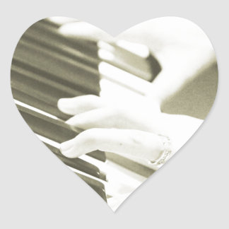 hands playing the piano photograph sepia heart sticker