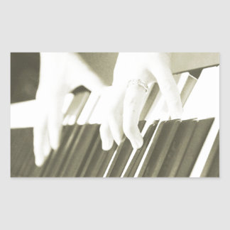 hands playing the piano photograph sepia rectangular sticker