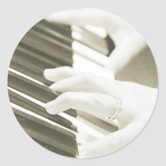hands playing the piano photograph sepia round sticker