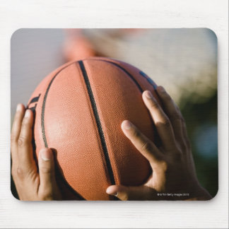 Hands shooting basketball outdoors mouse pad