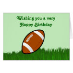 Happy Birthday with football on grass