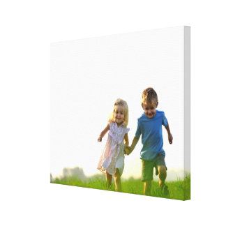 Happy boy and girl holding hands by healinglove canvas print