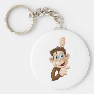 Happy cartoon monkey pointing keychain