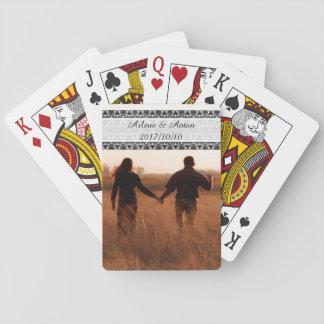 Happy couple strolling poker deck