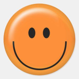 Happy orange smiley face round sticker