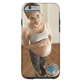 Happy pregnant woman standing on scale tough iPhone 6 case