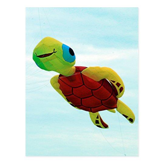 Happy turtle kite flying postcard