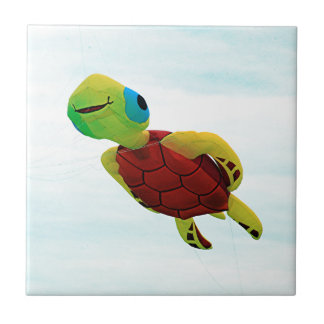 Happy turtle kite flying small square tile