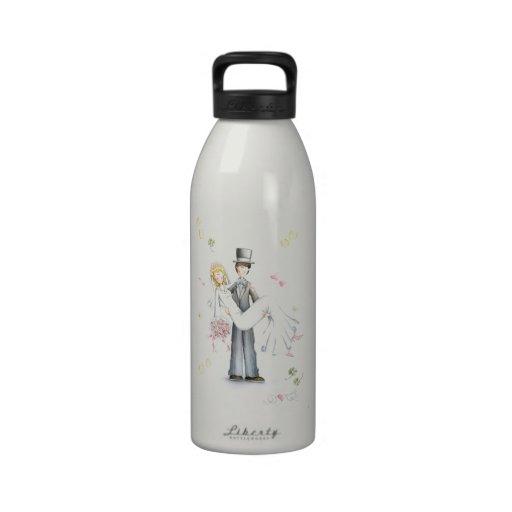 Happy wedding couple drinking bottle