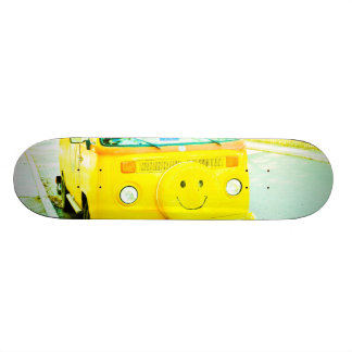 Happy yellow car skate boards