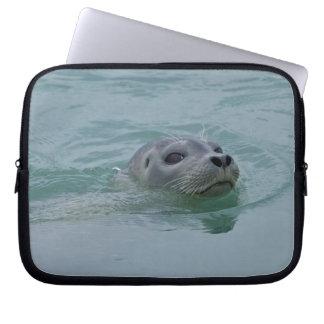 Harbor Seal swimming in Jokulsarlon glacial lake Laptop Sleeve