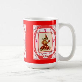 Harlequin with hearts coffee mug
