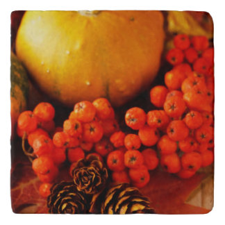 Harvested pumpkins with fall leaves 2 trivet
