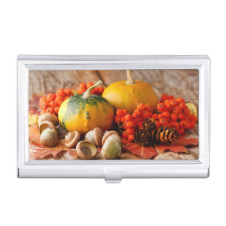 Harvested pumpkins with fall leaves business card holder