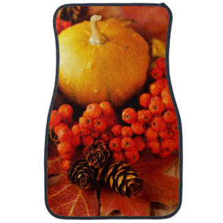 Harvested pumpkins with fall leaves car mat