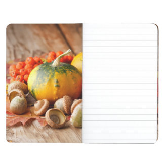 Harvested pumpkins with fall leaves journal