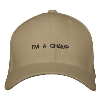 Hat with I'M A CHAMP across the front of it. Embroidered Baseball Cap