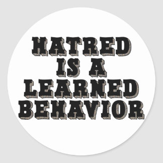 Hatred is a learned behavior round sticker