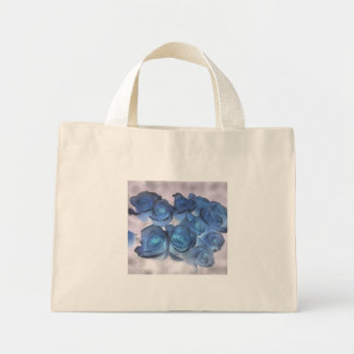 Hauntingly beautiful blue tinged roses mini tote bag