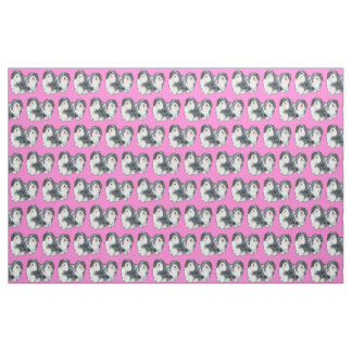 Havanese puppies on a pik background fabric