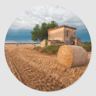 Hay bale in Provence field Classic Round Sticker