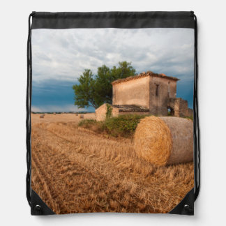 Hay bale in Provence field Drawstring Backpack