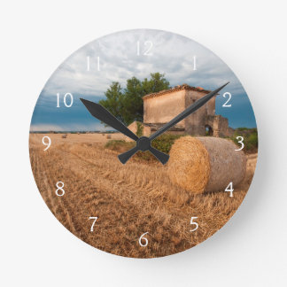 Hay bale in Provence field Round Clock