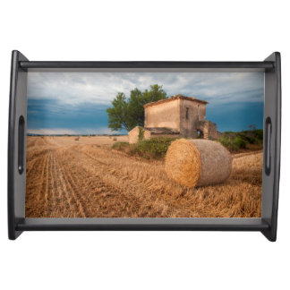 Hay bale in Provence field Serving Tray