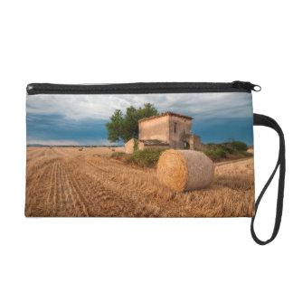 Hay bale in Provence field Wristlet Clutch